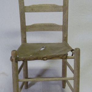 This handmade ladder-back chair has a rawhide seat. Settlers raised cattle along the outskirts of Galveston and the market downtown sold fresh beef during the hours of daybreak until six o'clock in the morning. Beef and fish cost less than pork as they were more readily available in Galveston.