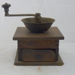 Texans used hand-cranked mills like these to grind their coffee beans. They poured the beans into the top. The handle turns a blade that pulverizes the beans into grounds, which fall into the drawer below.